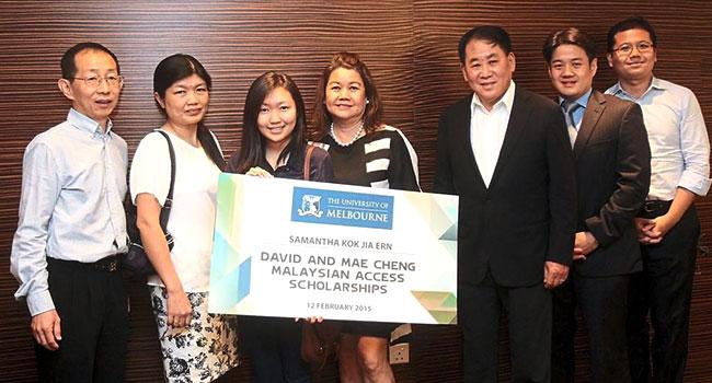 Student holding novelty scholarship card
