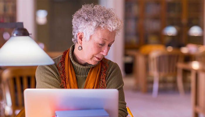 An older person in the library
