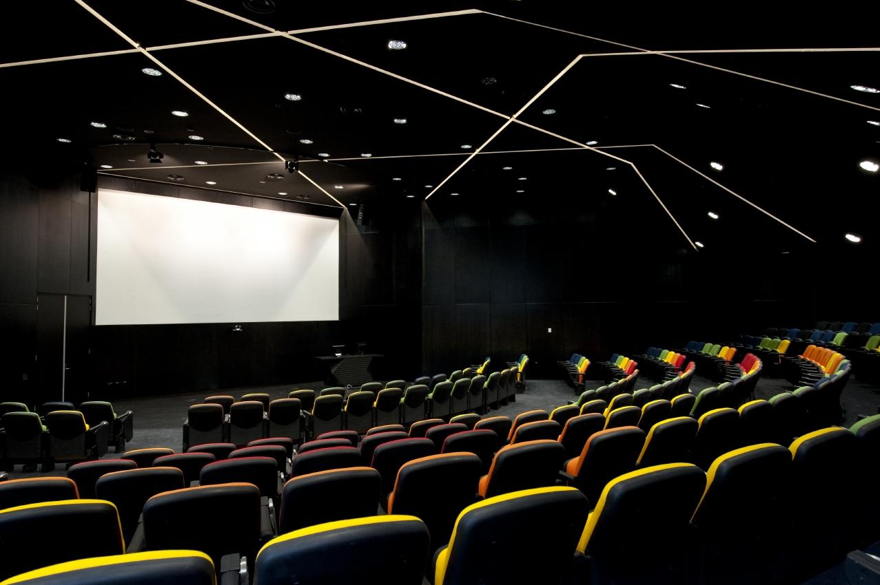 Lecture theatre with bright white screen