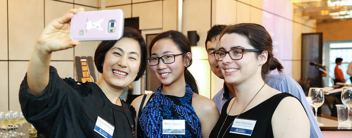 Three women at an Alumni Network event taking a selfie
