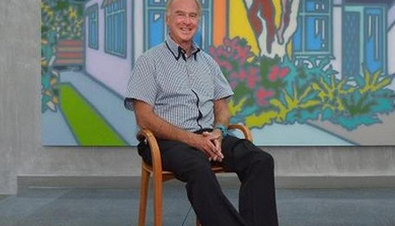 Michael Buxton sitting in front of artv