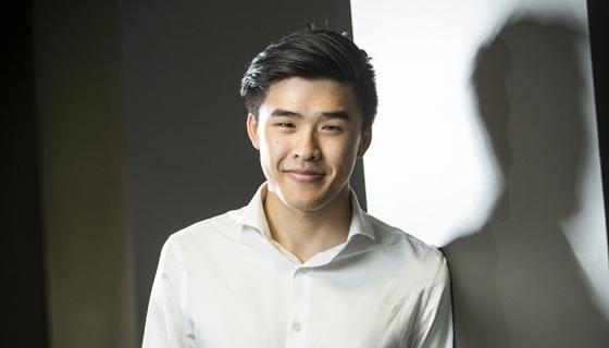 Eric Woo with shadow behind him