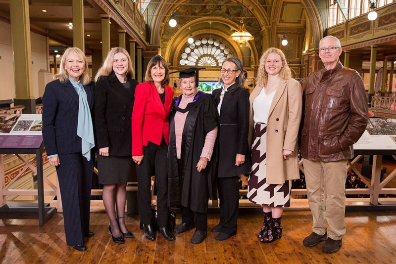 Master of Ageing Graduate Lorna (centre) stands with (left to right) Maureen Kindred (daughter), Victoria Haeusler (granddaughter), Rosemary Mckenzie (Director of Teaching and Learning - the Melbourne School of Population and Global Health at The University of Melbourne, Lorna Prendergast, Lena Gan (Program Director - Ageing in Society - Melbourne School of Population & Global Health, Madeleine Haeusler (granddaughter), Terry Prendergast (son).