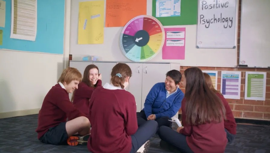 Students sitting in a circle in the classroom